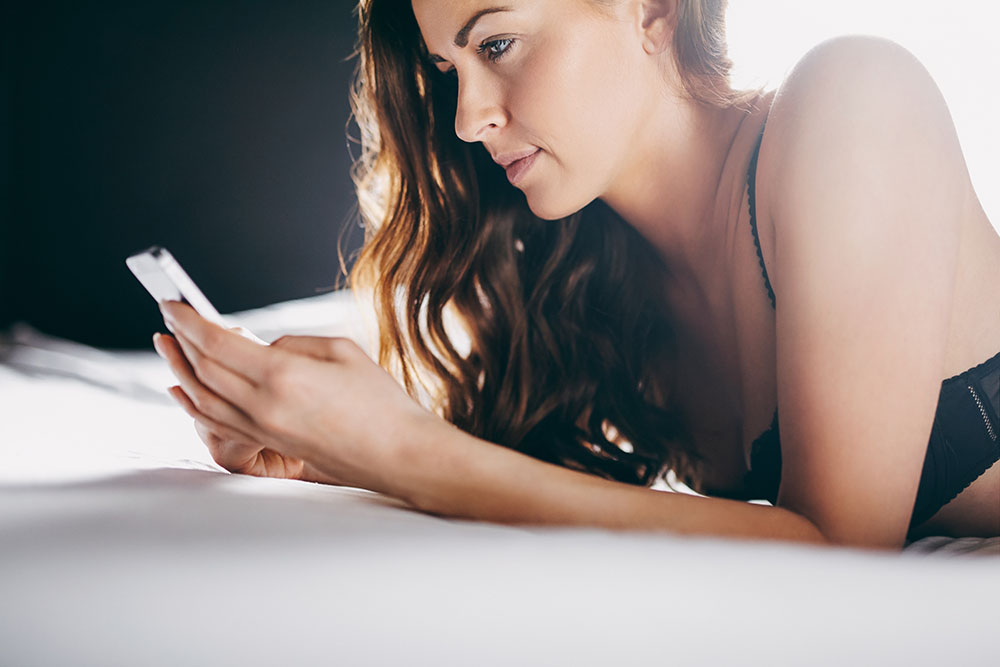 Woman looking at cybersex