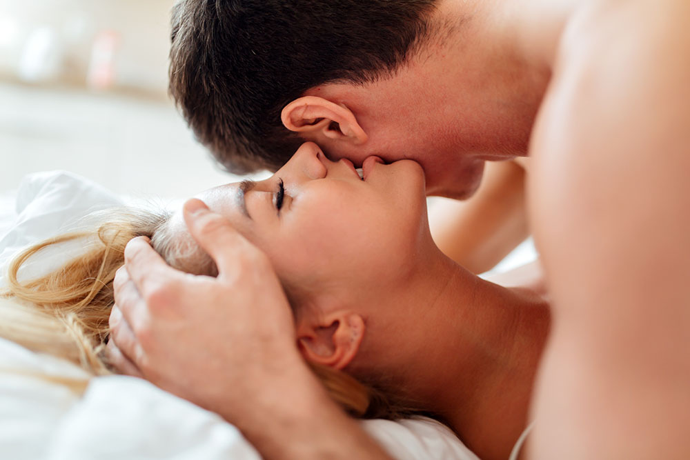 woman whispering sexual stories in her partner's ear