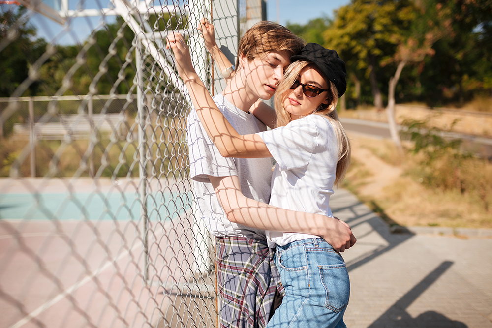 russian girl hugging a young man